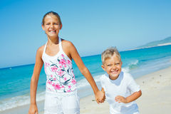 Cute boy and girl on the beach Royalty Free Stock Photography