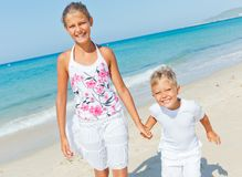 Cute boy and girl on the beach Royalty Free Stock Images