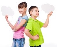 Cute boy and girl holding scraps of paper Stock Images