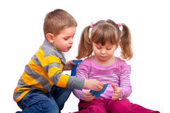 Cute boy and girl are playing with a cards Stock Images