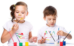 Cute boy and girl playing with paints Royalty Free Stock Photography
