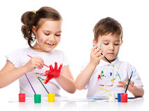 Cute boy and girl playing with paints Stock Photography
