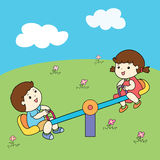 Cute boy and girl playing seesaw board  Royalty Free Stock Photography