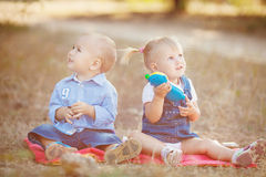 Cute boy and girl playing together summer outdoors Stock Photos