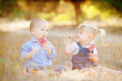 Cute boy and girl playing together summer outdoors Stock Photography