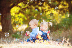 Cute boy and girl playing together summer outdoors Royalty Free Stock Images