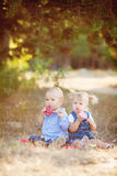 Cute boy and girl playing together summer outdoors Royalty Free Stock Photo