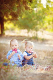 Cute boy and girl playing together summer outdoors Stock Image