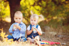 Cute boy and girl playing together summer outdoors Royalty Free Stock Photos