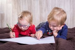 Twins writting letter for Santa Stock Photography