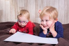 Twins writting letter for Santa Stock Photos
