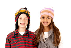 Cute boy and girl wearing winter hats smiling Royalty Free Stock Image