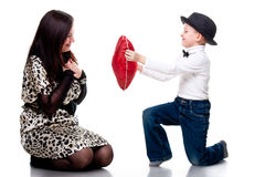 Cute boy giving red heart to his mother Royalty Free Stock Photography