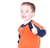 Cute boy giving thumbs up!. Cute boy giving thumbs up isolated on white Royalty Free Stock Photography