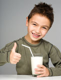 Cute boy with a glass of milk Royalty Free Stock Photos