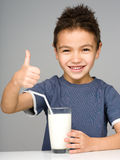 Cute boy with a glass of milk Stock Images