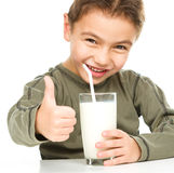 Cute boy with a glass of milk Stock Image