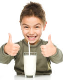 Cute boy with a glass of milk Royalty Free Stock Photography