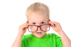 Cute boy with glasses in green shirt Stock Image