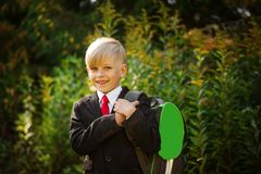 Cute boy going back to school. Boy in the suit. Closeup portrait of smiling pupil with backpack stock photos
