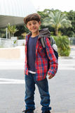 Cute boy going to school with backpack Royalty Free Stock Photo