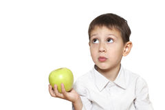 Cute boy with green apple Royalty Free Stock Image