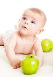 Cute boy with a green apple Stock Image