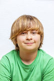 Cute boy in green shirt Royalty Free Stock Photography
