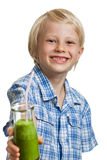 Cute boy with green smoothie or juice Stock Image