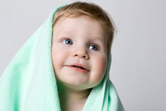Cute boy in a green towel Stock Photo