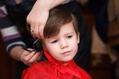 Cute boy haircut Stock Photography