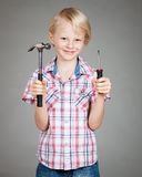 Cute boy hammer and screwdriver Stock Image