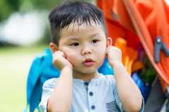 Cute boy with hand on ear. Cute boy with hand on his ear royalty free stock photography