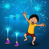 Cute boy for Happy Diwali celebration. Cute little boy enjoying firecrackers on creative shiny blue urban city background for Indian Festival of Lights, Happy Royalty Free Stock Image