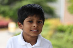 Cheerful boy smiling. A happy indian american cute boy portrait royalty free stock images