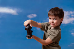 Cute boy having fun with joystick Royalty Free Stock Images