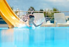 Cute boy having fun on water slide Stock Photography