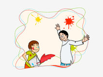 Cute boy with her father for Holi festival celebration. Royalty Free Stock Photo