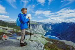 Cute boy with hiking equipment in the mountains Royalty Free Stock Photo