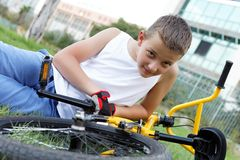 Cute boy with his bicycle outside Royalty Free Stock Photography