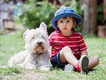 Cute boy with his dog friend Stock Photos