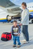 Cute boy and his grandmother prepared to fly Stock Photos