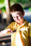 Cute boy holding baby turtle Stock Images