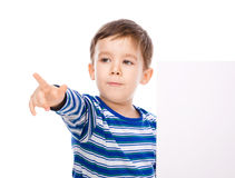Cute boy is holding blank banner Royalty Free Stock Photos