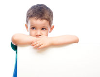 Cute boy is holding blank banner Royalty Free Stock Photo