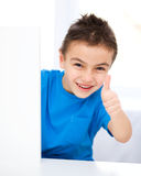 Cute boy is holding blank banner Royalty Free Stock Photography