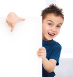 Cute boy is holding blank banner Stock Photo