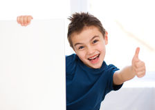 Cute boy is holding blank banner Royalty Free Stock Image