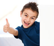 Cute boy is holding blank banner Stock Image