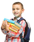 Cute boy is holding book. Education concept, isolated over white Stock Photo